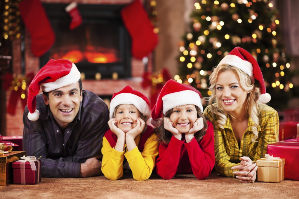 Cheerful family with Christmas presents.